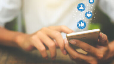 hand using smartphone with bluesocial media icons ilustrations