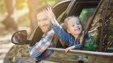 happy father and daughter in car