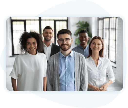 Group of diverse employees posing for picture looking at the camera
